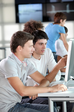 two young men working on website graphic design