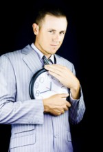 procrastinating man holding clock tightly